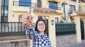 real estate sign : Happy young woman with New House Keys outdoors