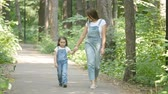 gezinmek : Family concept. Young mother and child daughter holding hands and walk Stok Video