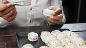 Concept of sweets and pastry. Pastry or baker chef making macarons