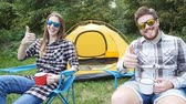 Young Happy couple sitting in tent during hiking trip Dostupné videozáznamy
