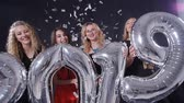 Happy New Year concept. Group of young women are having fun and holding bigger numbers 2019 Stock Footage