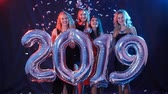 четыре человека : Happy New Year concept. Group of young women are having fun and holding bigger numbers 2019 Стоковые видеозаписи