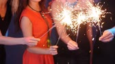 Party, holidays, nightlife and happy new year concept - Group of happy women having fun with sparklers