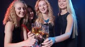 Concept of holidays and nightlife. Group of young beautiful women with glasses of champagne at a party