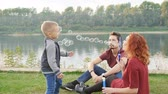 Love and parenthood concept. Happy Family with children blow soap bubbles outdoors Dostupné videozáznamy
