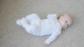 Concept of children and parenthood. Cute Happy Baby is Lying on Carpet Dostupné videozáznamy