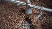 Dark and aromatic coffee beans in a modern roasting machine : 4k