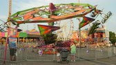 fairgrounds : NASHVILLE - SEPTEMBER 5: The Cliff Hanger carnival ride spins during the Tennessee State Fair on September 5, 2014 in Nashville, Tennessee. Stock Footage