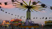 fairgrounds : NASHVILLE - SEPTEMBER 5: (Time-lapse) The Yo-Yo carnival ride spins on the midway during the Tennessee State Fair on September 5, 2014 in Nashville, Tennessee.