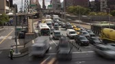 congestionamento : NEW YORK - OCTOBER 18: (Time-lapse) Mid-day traffic enters Manhattan from Queens on the Queensboro Bridge as the Roosevelt Island Tram leaves the station on October 18, 2012 in New York.
