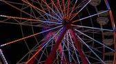 fairgrounds : The colorfully illuminated Gentle Giant Ferris Wheel spins against the night sky during the 2014 New Jersey State Fair at the Sussex County Fairgrounds in Augusta, New Jersey.