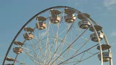fairgrounds : The Gentle Giant Ferris Wheel spins against the sky during the 2014 New Jersey State Fair at the Sussex County Fairgrounds in Augusta, New Jersey.