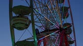 fairgrounds : The colorfully illuminated Gentle Giant Ferris Wheel spins against the twilight sky during the 2014 New Jersey State Fair at the Sussex County Fairgrounds in Augusta, New Jersey.