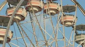 fairgrounds : Closeup view as the Gentle Giant Ferris Wheel spins against the sky during the 2014 New Jersey State Fair at the Sussex County Fairgrounds in Augusta, New Jersey.