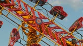 fairgrounds : The Zipper carnival ride spins against the sky during the 2014 New Jersey State Fair at the Sussex County Fairgrounds in Augusta, New Jersey. Stock Footage