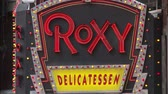 vezes : NEW YORK - MARCH 10: The lighted marquee sign for the Roxy Delicatessen flashes in Times Square on March 10, 2013 in New York City.