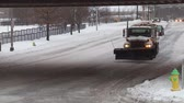 arando : WHITE PLAINS, NY - FEBRUARY 5: A DPW snow plowsand spreader passes under the Metro-North tracks on Main Street (NY Route 119) after a heavy snowfall on February 5, 2014 in White Plains.
