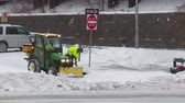 clareira : WHITE PLAINS, NY - FEBRUARY 5: Department of Public Works workers clear a municipal parking lot and sidewalks after a heavy snowfall on February 5, 2014 in White Plains. Stock Footage