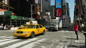 хакер : NEW YORK - MAY 18: Taxis and other vehicular traffic move through Times Square along 7th Avenue on May 18, 2014 in New York City. Стоковые видеозаписи