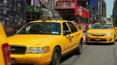vezes : NEW YORK - MAY 18: Taxis and other vehicular traffic move through Times Square along 7th Avenue on May 18, 2014 in New York City. Stock Footage