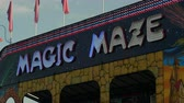 fairgrounds : AUGUSTA, NJ - AUGUST 6: An illuminated sign for the Magic Maze flashes during the New Jersey State Fair at the Sussex County Fairgrounds on August 6, 2014 in Augusta, New Jersey. Stock Footage