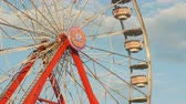 fairgrounds : AUGUSTA, NJ - AUGUST 5: The Gentle Giant Ferris Wheel spins against the sky during the New Jersey State Fair at the Sussex County Fairgrounds on August 5, 2014 in Augusta, New Jersey.