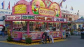 fairgrounds : AUGUSTA, NJ - AUGUST 6: A family stops for cotton candy at one of the concession stands on the midway during the New Jersey State Fair on August 6, 2014 at the Sussex County Fairgrounds in Augusta, New Jersey.