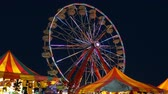fairgrounds : AUGUSTA, NJ - AUGUST 6: The colorfully illuminated Gentle Giant Ferris Wheel spins against the twilight sky during the New Jersey State Fair on August 6, 2014 at the Sussex County Fairgrounds in Augusta, New Jersey.