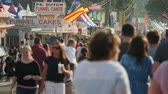 fairgrounds : AUGUSTA, NJ - AUGUST 6: People walk on the midway during the New Jersey State Fair on August 6, 2014 at the Sussex County Fairgrounds in Augusta, New Jersey. Stock Footage