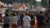 fairgrounds : AUGUSTA, NJ - AUGUST 7: (Slow Motion) People walk on the midway during the New Jersey State Fair on August 7, 2014 at the Sussex County Fairgrounds in Augusta, New Jersey.