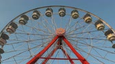 fairgrounds : AUGUSTA, NJ - AUGUST 7: The Gentle Giant Ferris Wheel spins against the sky during the New Jersey State Fair at the Sussex County Fairgrounds on August 7, 2014 in Augusta, New Jersey.