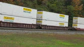 cargo container : ALTOONA, PA - OCTOBER 3: A Norfolk Southern freight train with intermodal containers passes through Horseshoe Curve on October 3, 2014 in Altoona, Pennsylvania.
