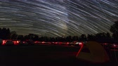 (Time-lapse) Stars create star trails in the sky over the astronomy field at Cherry Springs State Park, an International Dark Sky Park in West Branch Township, Pennsylvania. Stock Footage