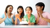 happy : Slow motion happy moment of Asian family blowing birthday candles Stock Footage