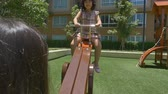 little : Asian child playing at playground in a park Stock Footage