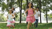 forest : Asian family running together in the park