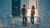 srdce : Romantic couple holding Valentines gift standing on the balcony on a date. Dostupné videozáznamy
