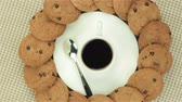 aveia : Cookies, spoon and cup of coffee, video on colour napkin Vídeos