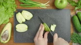 Footage of cooking salad with vegetables on black board Stock mozgókép