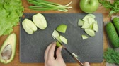 Footage of cooking green salad on black board Stock mozgókép