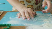 cut off : Woman Kneads the Dough and Rolls out the Dough with a Yellow Rolling Pin Stock Footage