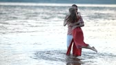 carry : Young man twirls his girlfriend in the water Stock Footage