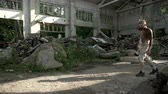 abduction : Crazy maniac walks in a ruined building debris Stock Footage