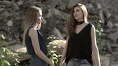 abduction : Two girls communicate with each other and behind their backs a maniac sits Stock Footage