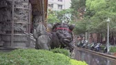 Stone lion and classical architecture in Asian temple. Стоковые видеозаписи