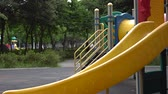 Colorful playground for kids. Amusement equipments in the park. In Asia. Стоковые видеозаписи