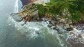 encounter : top aerial coastline view and waves crashing on rocky cliff shoreline Stock Footage