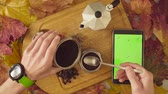 Autumn still life. Chroma key tablet and coffee Stock Footage