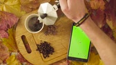 kaydırma : Autumn still life. Chroma key tablet and coffee Stok Video