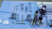 operating table : The medical instruments are laying on the table. Stock Footage